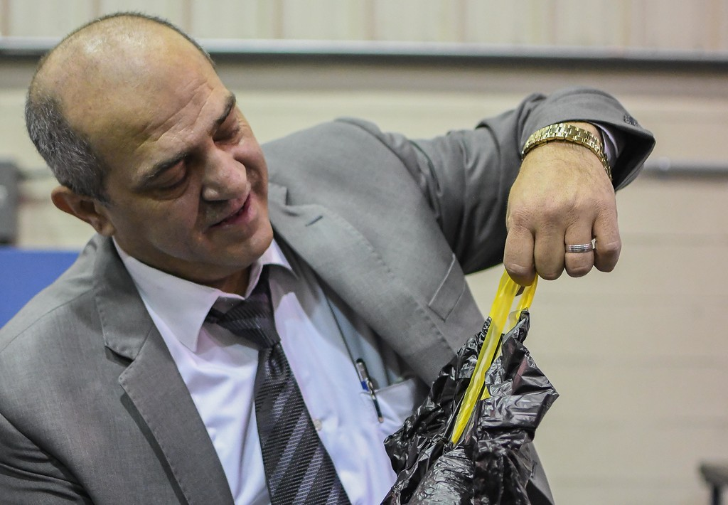 . CEO Makki Odeh shows the plastic draw strings which are installed into new, easy to open plastic bags at Global Plastic Technologies Inc., April 27, 2018. (Eric Bonzar�The Morning Journal)