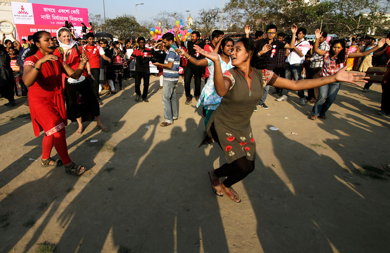 ". Women and activists participate in an event to support ""One Billion Rising\"" global campaign in Kolkata, India, Thursday, Feb. 14, 2013. Flashmobs, rallies with singing and dancing were organized across the country as part of the campaign, timed to coincide with Valentine\'s Day, to bring an end to violence against women. (AP Photo/Bikas Das)"