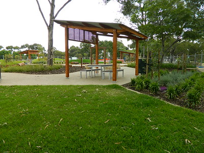 timber post and rail with steel roof shade structure and bbq table and benches