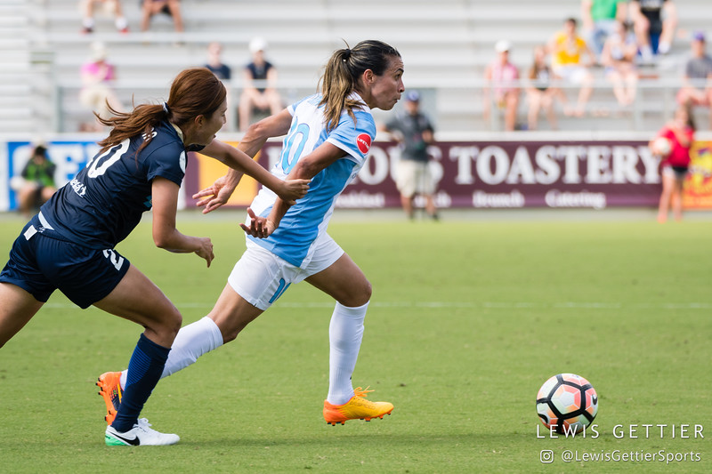 Marta (10) and Yuri Kawamura (20) during a match between the NC Courage and the Orlando Pride in Cary, NC in Week 3 of the 2017 NWSL season. Photo by Lewis Gettier.