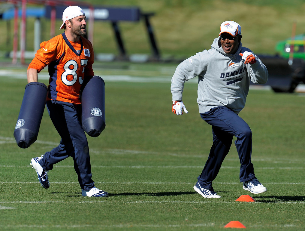 . ENGLEWOOD, CO - OCTOBER 27: Denver Broncos Wes Welker (83) helps out with drills as WR coach Tyke Tolbert runs a pass pattern during practice on October 30, 2013 at Dove Valley. (Photo by John Leyba/The Denver Post)