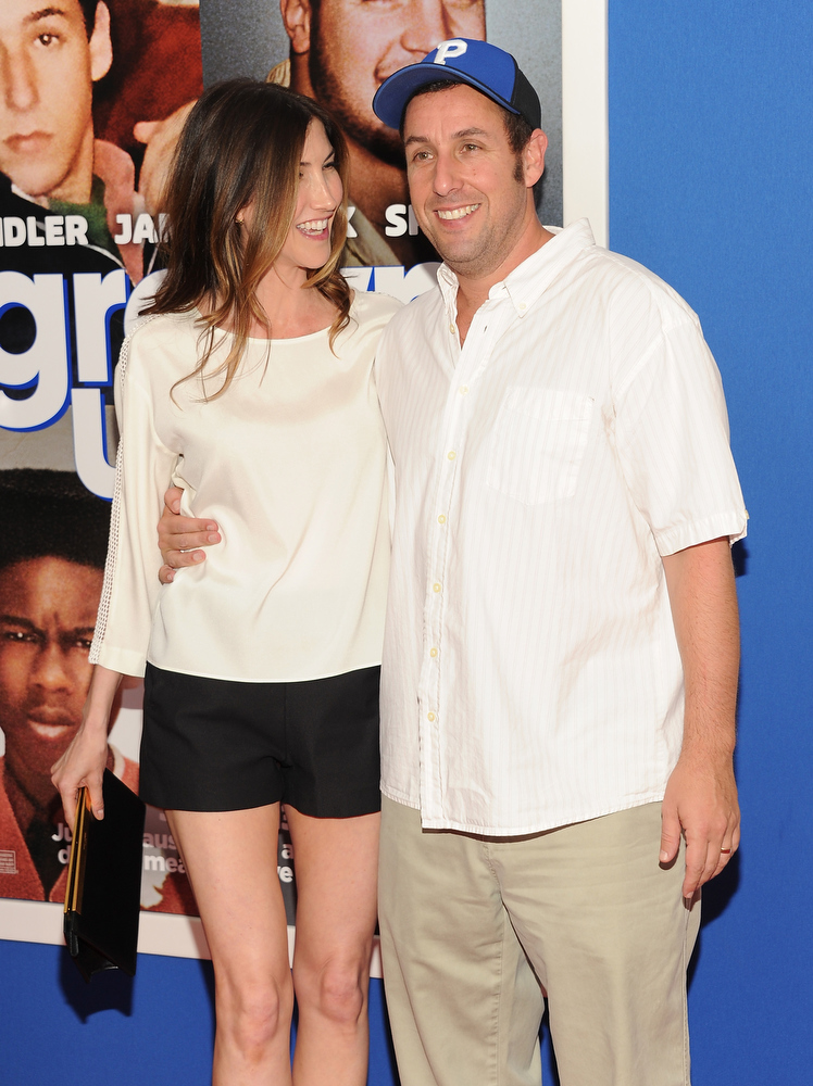""". Actor Adam Sandler and wife Jackie attend the premiere of \""""Grown Ups 2\"""" at the AMC Loews Lincoln Square on Wednesday, July 10, 2013 in New York. (Photo by Evan Agostini/Invision/AP)"""