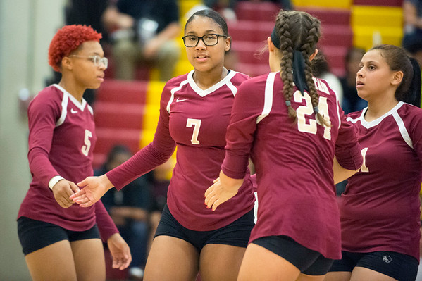 09/16/19 Wesley Bunnell | StaffrrNew Britain volleyball players Raven Symone-Jarrett (5), Anyerinia Lugo (7) and Audrey Belliveau (24) celebrate after a point.
