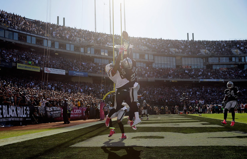. Tarell Brown #23 of the Oakland Raiders breaks up a pass intended for Antonio Gates #85 of the San Diego Chargers at O.co Coliseum on October 12, 2014 in Oakland, California.  (Photo by Ezra Shaw/Getty Images)