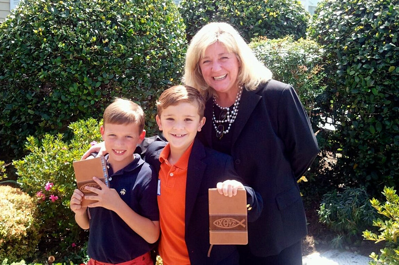 Charlie and Drew share the excitement of 3rd grade Bibles with their 3rd grade teacher, Angie Davenport