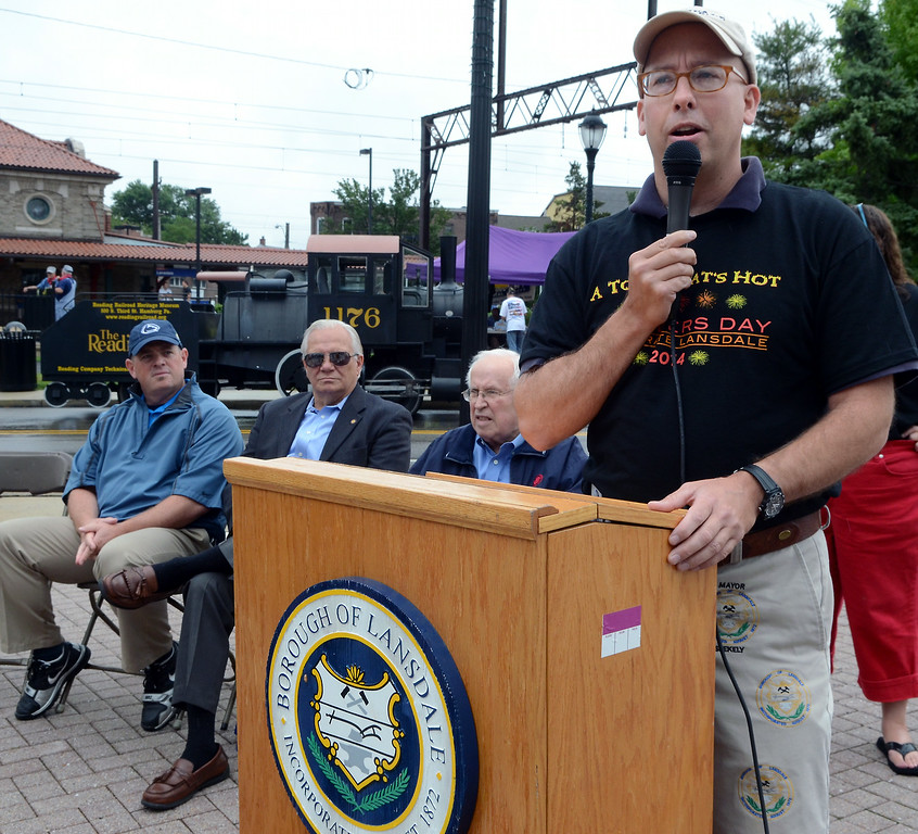 . Mayor Andy Szekely speaks as the Lansdale Borough Lifetime Achievement Award is presented to the family of Stephen Frederick during the Lansdale Founders Day  celebration and on Saturday August 23,2014. Photo by Mark C Psoras/The Reporter