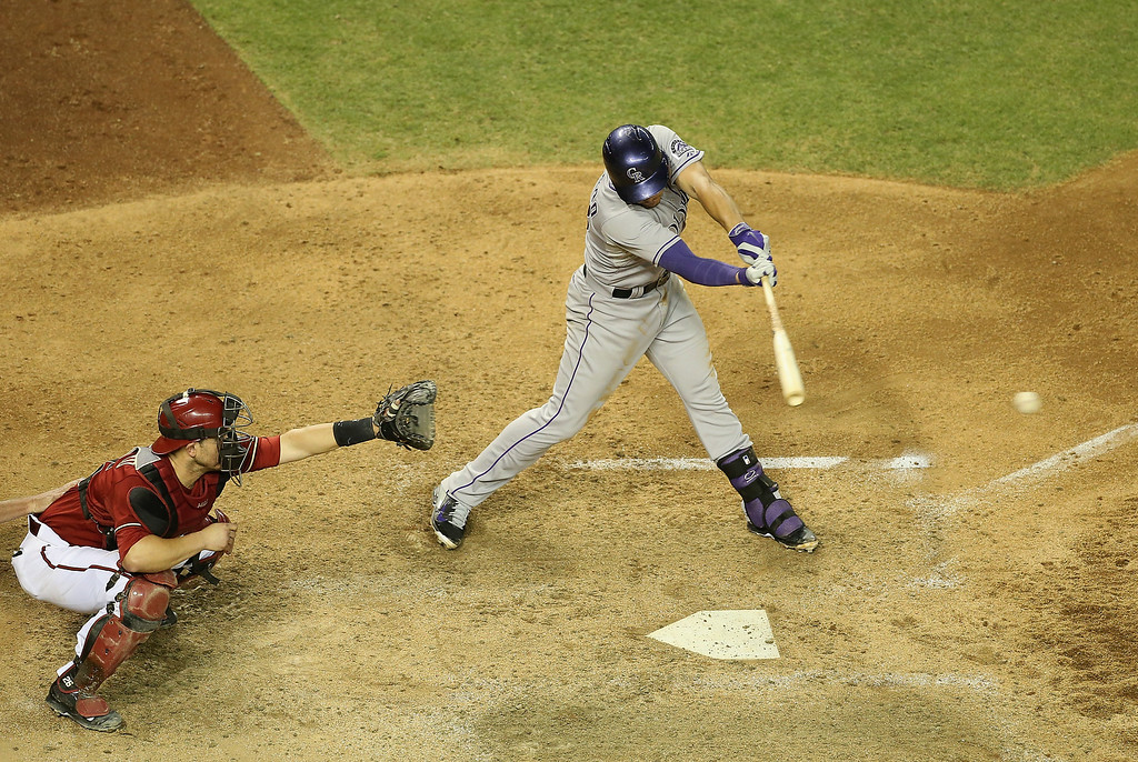 . Nolan Arenado #28 of the Colorado Rockies hits a single against the Arizona Diamondbacks during the sixth inning of the MLB game at Chase Field on April 30, 2014 in Phoenix, Arizona.  (Photo by Christian Petersen/Getty Images)