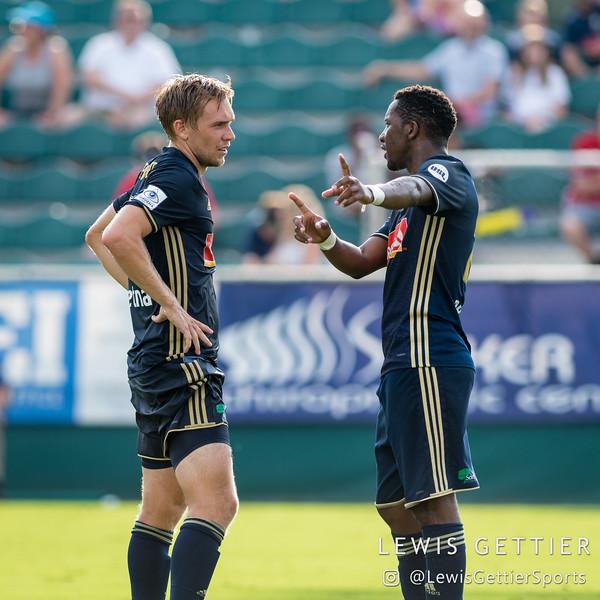 North Carolina FC midfielder Zach Steinberger (23) and North Carolina FC midfielder Tiyi Shipalane (22)