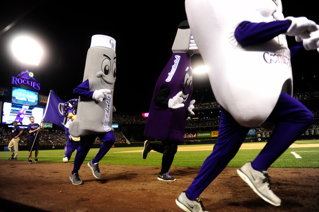. DENVER - JUNE 28: Dentistry themed mascots race around the diamond during a baseball game between the Colorado Rockies and the San Francisco Giants on June 28, 2013 at Coors Field.  (Photo By Grant Hindsley / The Denver Post)