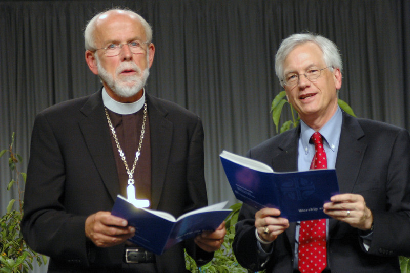 Bishop Hanson and Secretary Swartling close Plenay 11 with song.