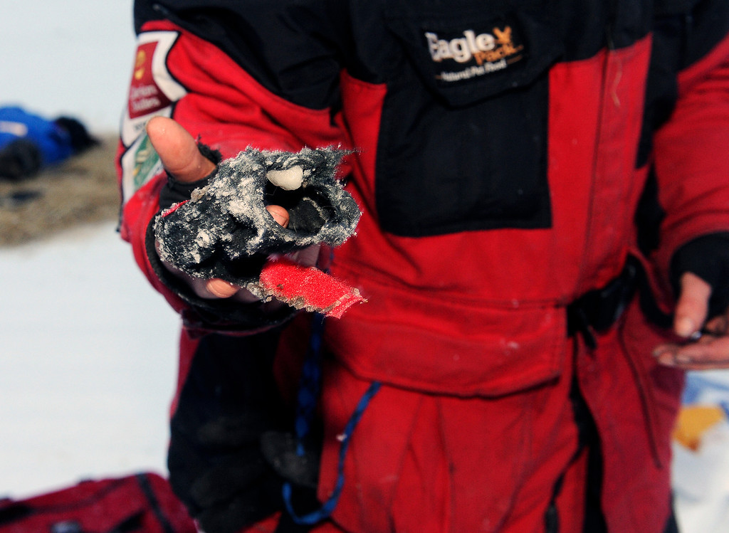 . Aliy Zirkle shows one of her dog booties that is completely worn through after 25 miles on the Farewell Burn at the Nikolai checkpoint in Nikolai, Alaska, during the 2014 Iditarod Trail Sled Dog Race on Tuesday, March 4, 2014. (AP Photo/The Anchorage Daily News, Bob Hallinen)