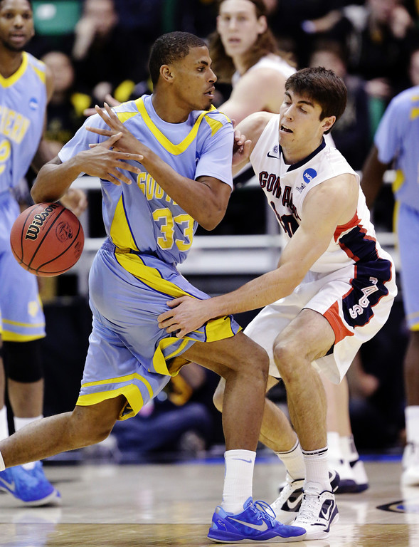 . Gonzaga\'s Mike Hart (30) knocks the ball from Southern University\'s Malcolm Miller (33) in the first half during a second-round game in the NCAA college basketball tournament in Salt Lake City, Thursday, March 21, 2013. (AP Photo/Rick Bowmer)