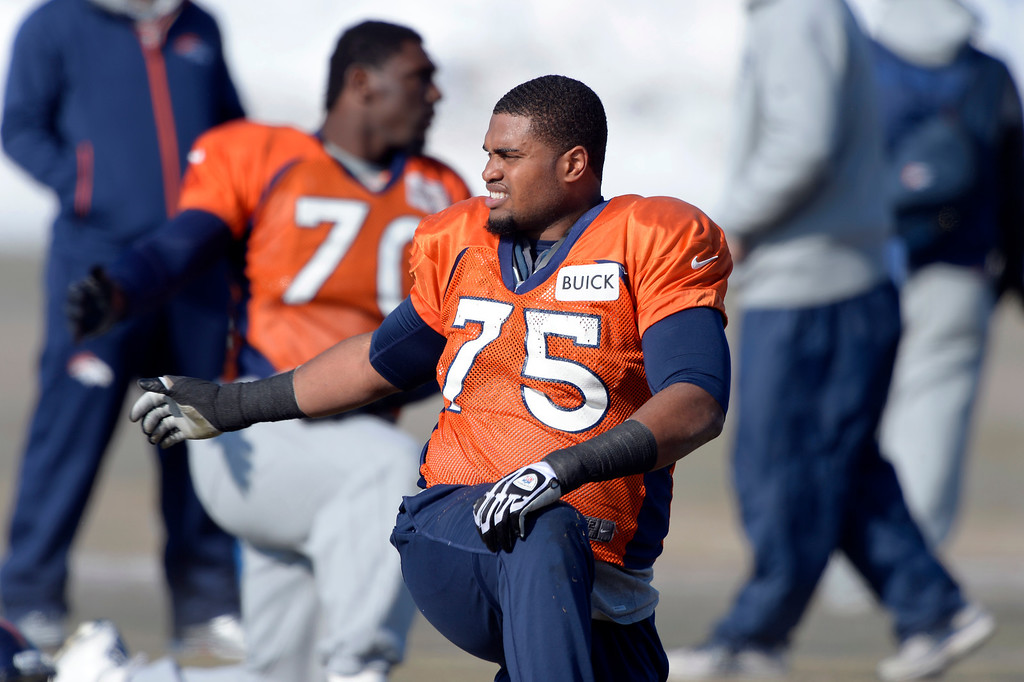 . Denver Broncos tackle Chris Clark (75) stretches before practice January 23, 2014 at Dove Valley.   (Photo by John Leyba/The Denver Post)