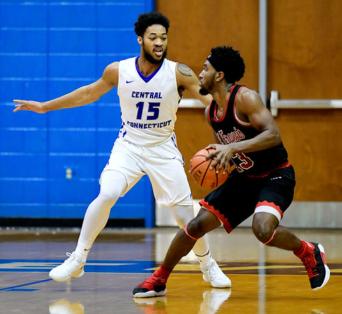 1/19/2019 Mike Orazzi | Staff CCSU's Jamir Coleman (15) and Saint Francis University's Keith Braxton (13) during Saturday's Men's basketball game in New Britain.