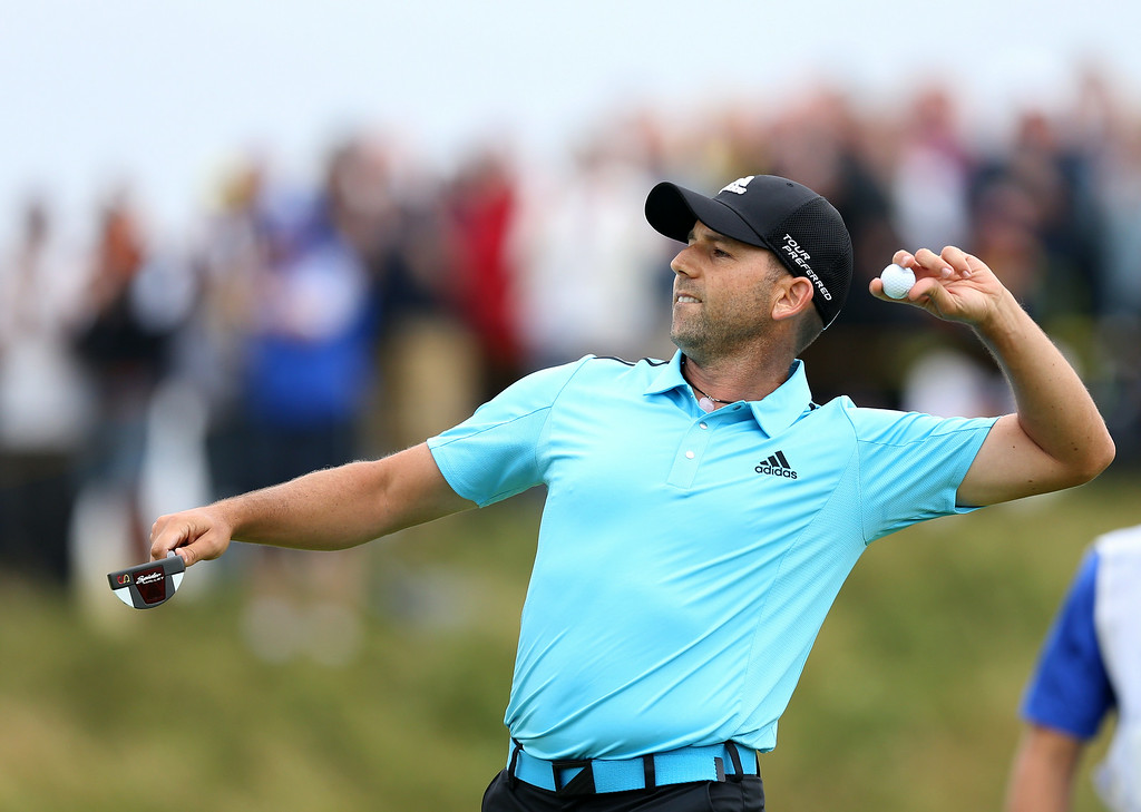 . Sergio Garcia of Spain throws his golf ball to the crowd after hitting the stands on the 12th hole during the final round of the British Open Golf championship at the Royal Liverpool golf club, Hoylake, England, Sunday July 20, 2014. (AP Photo/Scott Heppell)