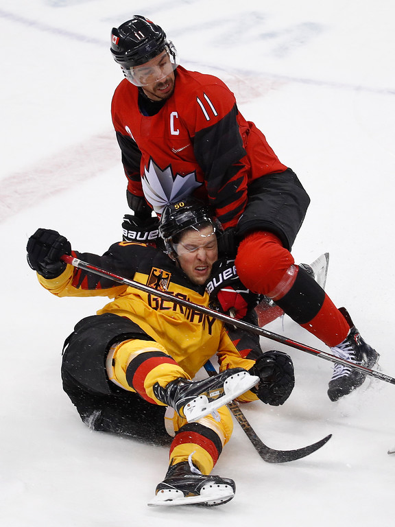 . Chris Kelly (11), of Canada, checks Patrick Hager (50), of Germany, during the first period of the semifinal round of the men\'s hockey game at the 2018 Winter Olympics in Gangneung, South Korea, Friday, Feb. 23, 2018. (AP Photo/Patrick Semansky)