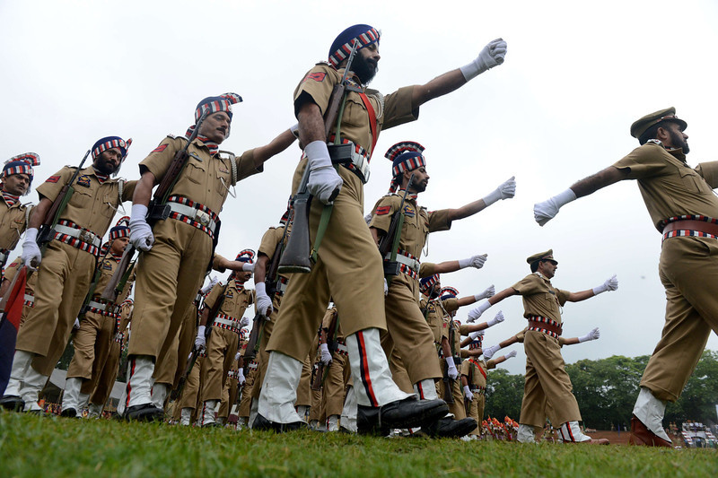 """. Jammu and Kashmir Police (JKP) personnel march during celebrations marking India\'s Independence Day at The Bakshi Stadium in Srinagar on August 15, 2013. Premier Manmohan Singh warned Pakistan August 15 against using its soil for \""""anti-India activity\"""", following a fresh escalation of tensions between the nuclear-armed neighbours over a deadly attack on Indian soldiers.  TAUSEEF MUSTAFA/AFP/Getty Images"""