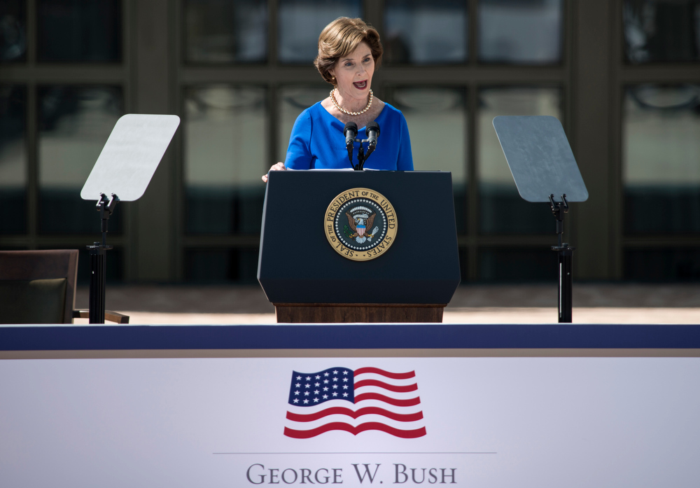 Description of . Former First Lady Laura Bush speaks during a dedication ceremony at the George W. Bush Library and Museum on the grounds of Southern Methodist University April 25, 2013 in Dallas, Texas. The Bush library, which is located on the campus of Southern Methodist University, with more than 70 million pages of paper records, 43,000 artifacts, 200 million emails and four million digital photographs, will be opened to the public on May 1, 2013.   BRENDAN SMIALOWSKI/AFP/Getty Images