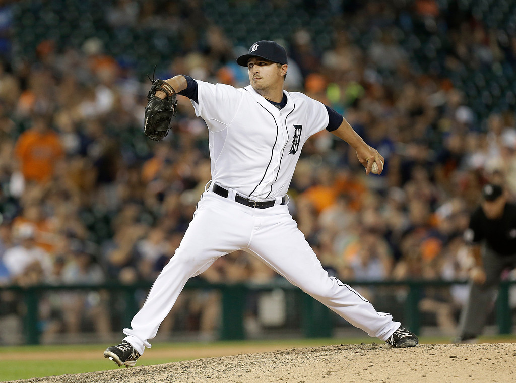 . Detroit Tigers pitcher Blaine Hardy throws against the Kansas City Royals in the eighth inning of a baseball game in Detroit, Tuesday, June 17, 2014.  (AP Photo/Paul Sancya)