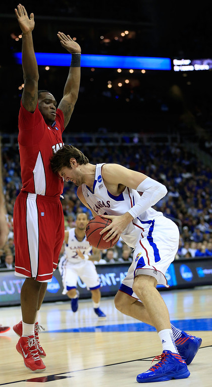 . KANSAS CITY, MO - MARCH 22: Jeff Withey #5 of the Kansas Jayhawks drives against Kene Anyigbo #0 of the Western Kentucky Hilltoppers in the second half during the second round of the 2013 NCAA Men\'s Basketball Tournament at the Sprint Center on March 22, 2013 in Kansas City, Missouri.  (Photo by Jamie Squire/Getty Images)