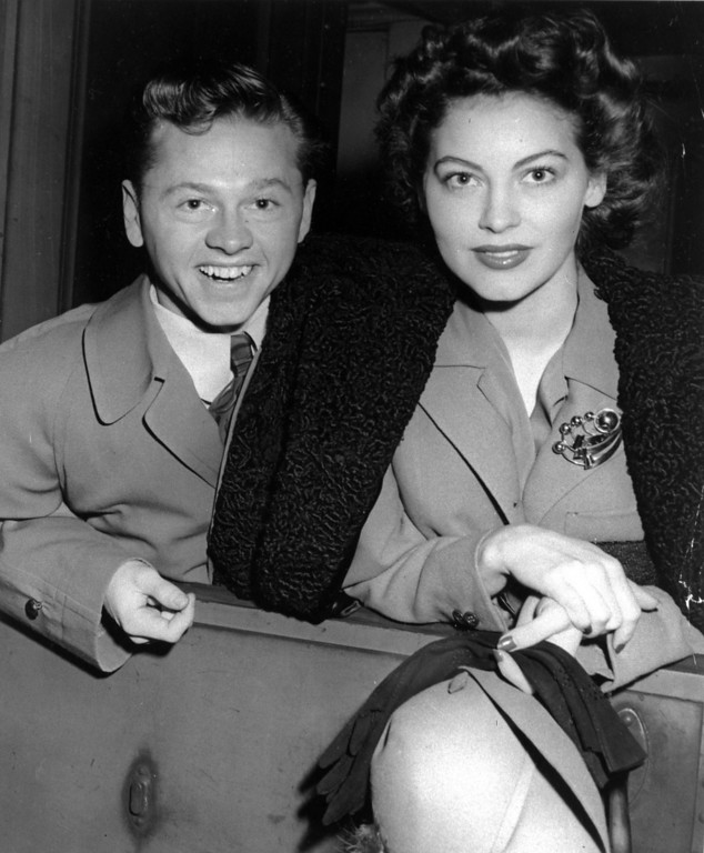 . Mickey Rooney and wife, Ava Gardner, arrive in New York in January 1942, en route to Boston where Rooney is to appear at a Red Cross benefit.  (AP Photo/File)