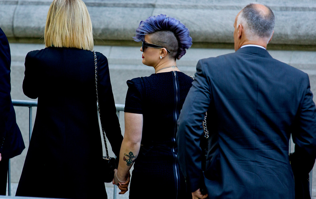 . Kelly Osbourne, center, arrives at a funeral service for comedian Joan Rivers at Temple Emanu-El in New York, Sunday, Sept. 7, 2014. Rivers died Thursday, Sept. 4, 2014. She was 81. (AP Photo/Craig Ruttle)