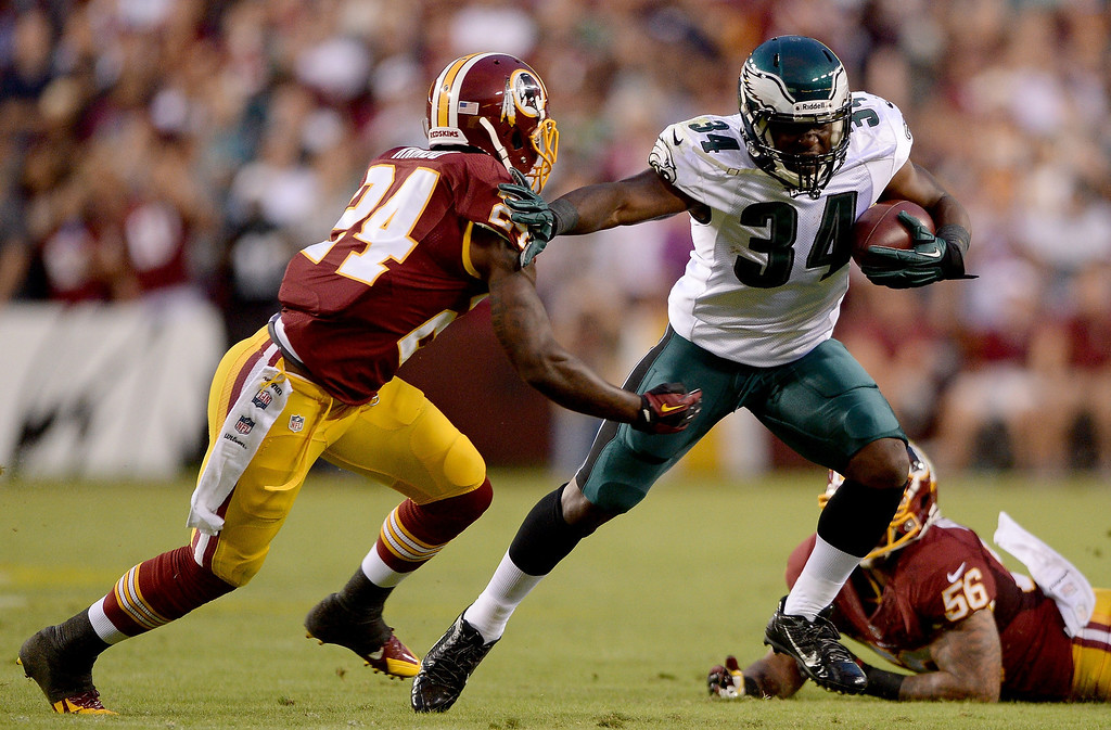 . Running back Bryce Brown #34 of the Philadelphia Eagles runs the ball in the first half against strong safety Bacarri Rambo #24 of the Washington Redskins at FedExField on September 9, 2013 in Landover, Maryland.  (Photo by Patrick Smith/Getty Images)