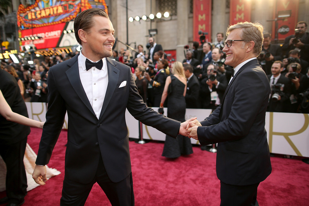 . Actors Leonardo DiCaprio (L) and Christoph Waltz attend the Oscars held at Hollywood & Highland Center on March 2, 2014 in Hollywood, California.  (Photo by Christopher Polk/Getty Images)
