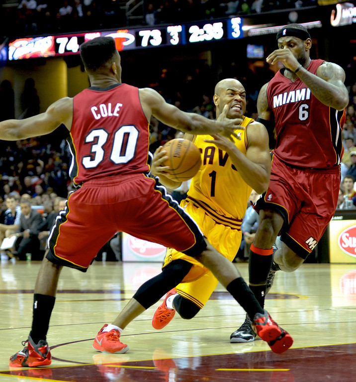 . Jeff Forman/JForman@News-Herald.com Jarrett Jack drives to the basket between Norris Cole and LeBron James in the fourth quarter of the Cavaliers\' 100-96 loss to the Heat March 18 at Quicken Loans Arena.