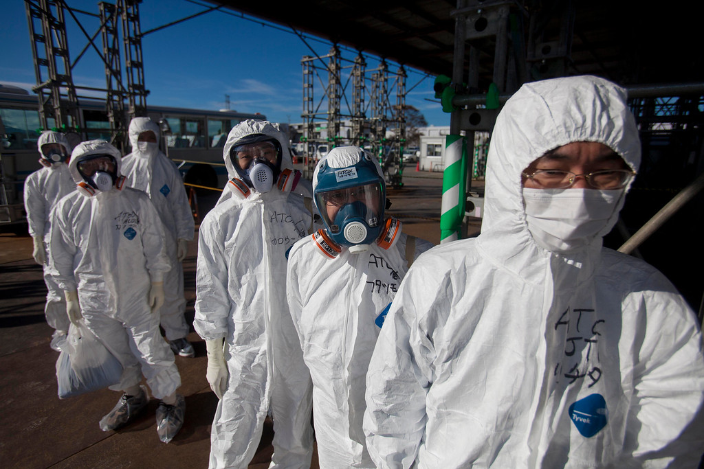 . FILE - In this Nov. 12, 2011 file photo, workers in protective suits and masks wait to enter the emergency operation center at the crippled Fukushima Dai-ichi nuclear power station in Okuma, Japan. (AP Photo/David Guttenfelder, Pool, File)