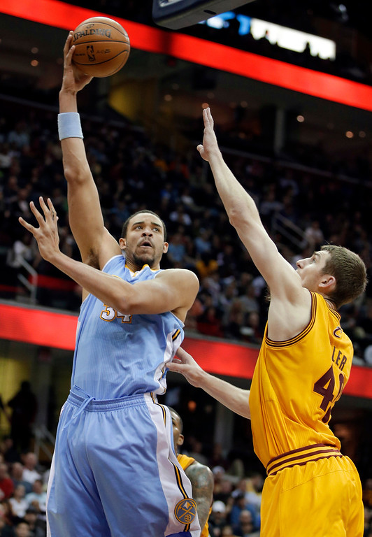 . Denver Nuggets\' JaVale McGee shoots over Cleveland Cavaliers\' Tyler Zeller during the third quarter of an NBA basketball game Saturday, Feb. 9, 2013, in Cleveland. The Nuggets won 111-103. (AP Photo/Mark Duncan)