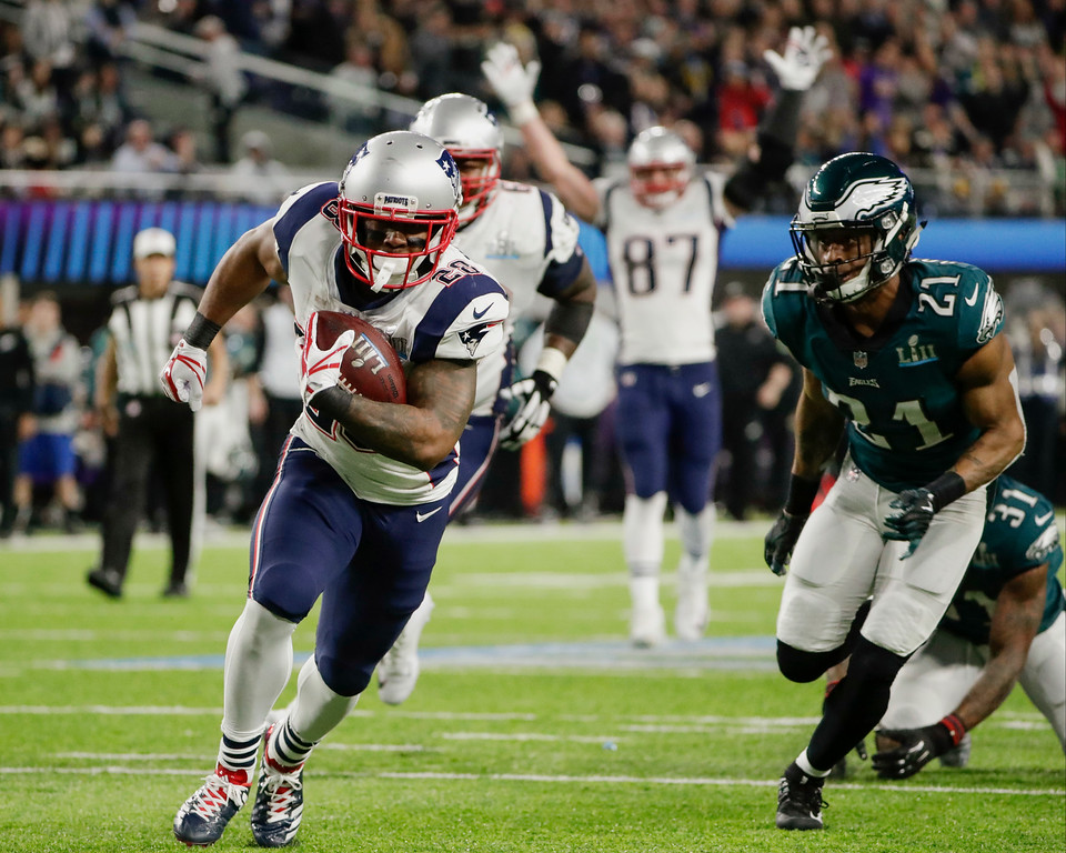 . New England Patriots running back James White (28) runs to the end zone for a touchdown, during the first half of the NFL Super Bowl 52 football game against the Philadelphia Eagles Sunday, Feb. 4, 2018, in Minneapolis. (AP Photo/Frank Franklin II)