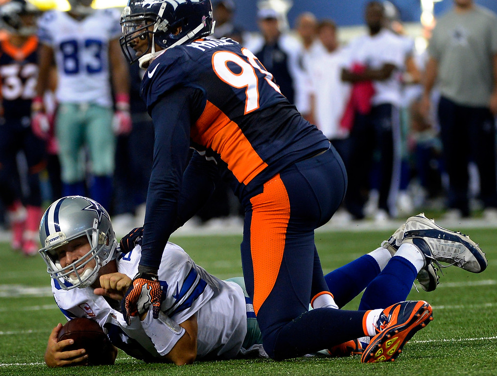 . Defensive end Shaun Phillips #90 of the Denver Broncos corrals quarterback Tony Romo #9 of the Dallas Cowboys during the second half. (Photo By Joe Amon/The Denver Post)