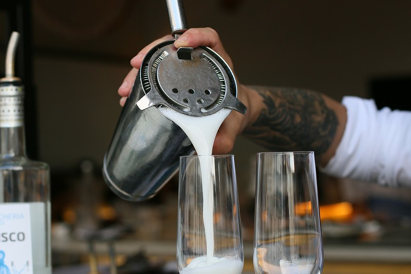 Pisco sour being poured in Lima