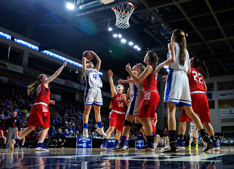 BANGOR, Maine -- 02/21/2017 -- Madawaska's Hannah Nadeau (second from left) puts up a shot past Dexter during their Class C girls basketball quarterfinal game at the Cross Insurance Center in Bangor Tuesday. Ashley L. Conti | BDN