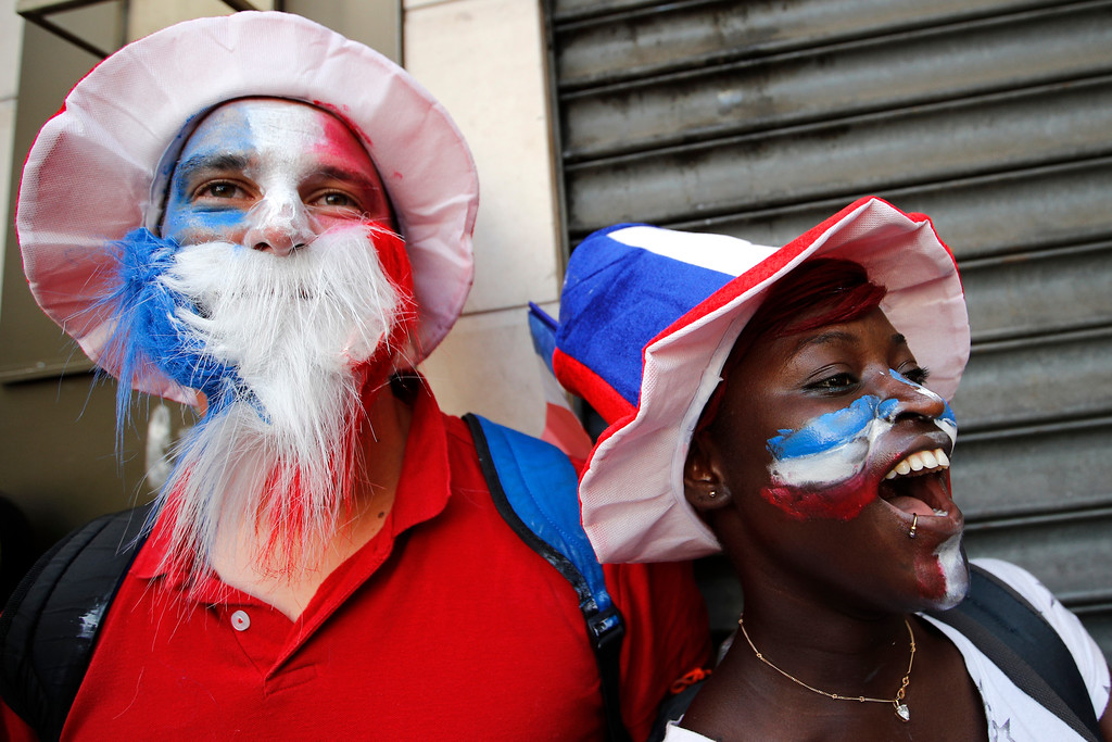. French soccer team supporters react after won France won the soccer World Cup final match between France and Croatia, Sunday, July 15, 2018 in a cafe in Paris. France won its second World Cup title by beating Croatia 4-2 . (AP Photo/Francois Mori)