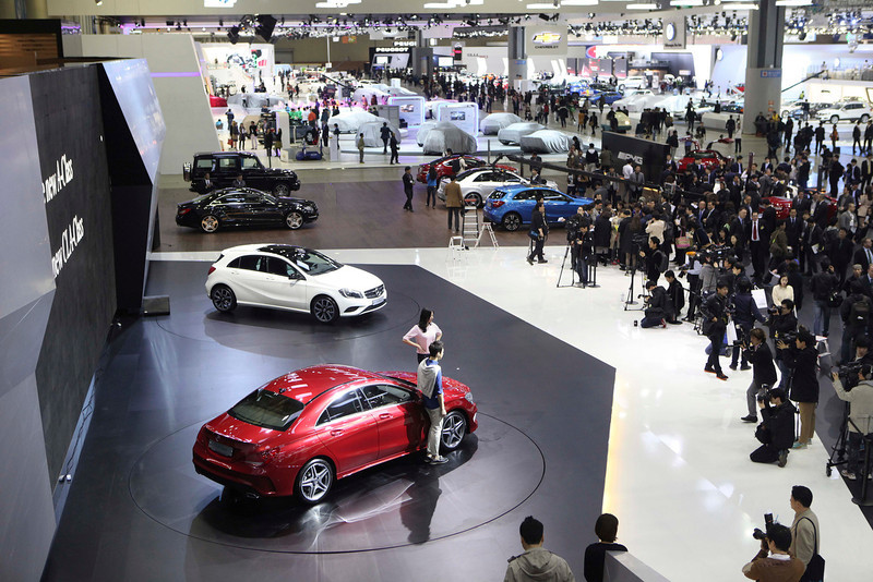 """. South Korean models pose with Mercedes Benz \""""The New A-Class,\"""" bottom, during a press day of the Seoul Motor Show in Goyang, South Korea, Thursday, March 28, 2013. The exhibition, with 384 companies from 14 countries to participate, will be held from March 29 through April 7.(AP Photo/Ahn Young-joon)"""