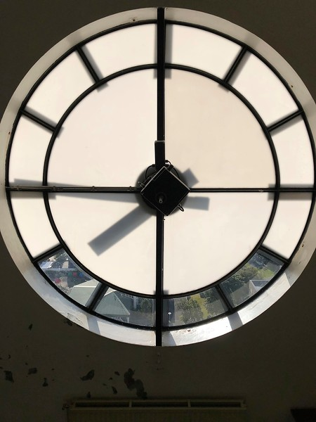 Telling time from the back - the clock in Hallgrimskirkja