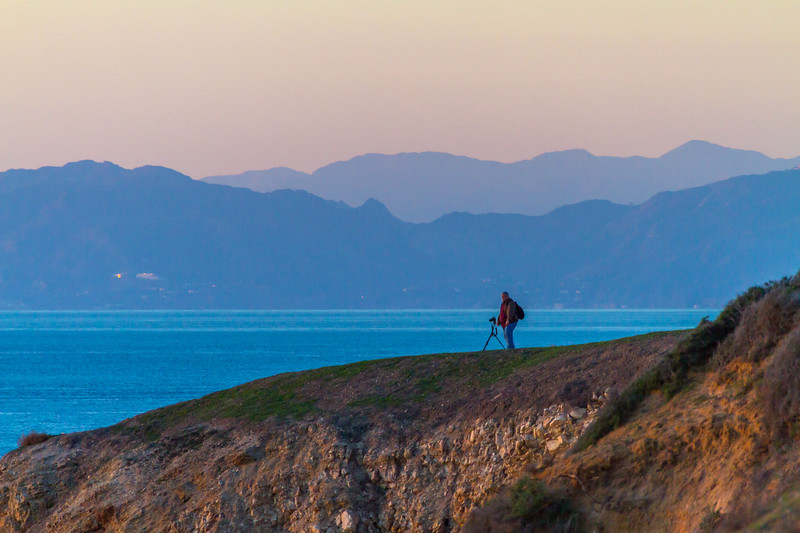 Photographer standing on cliff with camera - USA - California