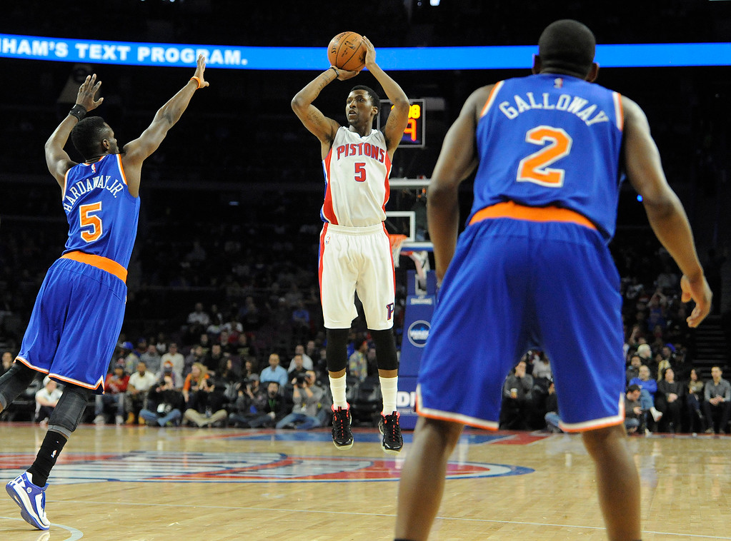 . Detroit Pistons guard Kentavious Caldwell-Pope (5) puts up a shot past New York Knicks defenders Tim Hardaway Jr., left, and Langston Galloway in the first quarter, Friday, Feb. 27, 2015 at The Palace in Auburn Hills, Mich.  (Special to The Oakland Press/Jose Juarez)