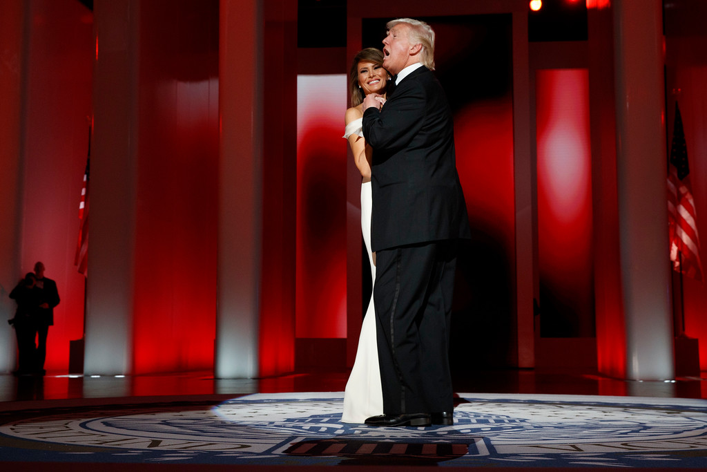 ". President Donald Trump sings ""My Way\"" as he dances with first lady Melania Trump at the Liberty Ball Friday, Jan. 20, 2017, in Washington. (AP Photo/Evan Vucci)"