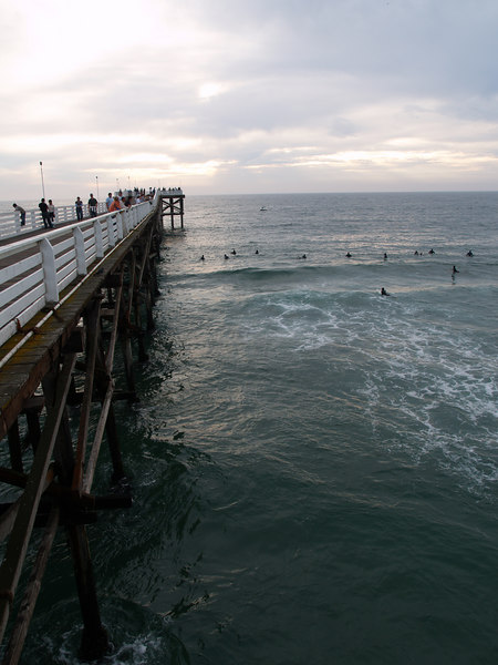Surfing Pacific Beach at Crystal Pier at sunset Oct. 1, 2006 84