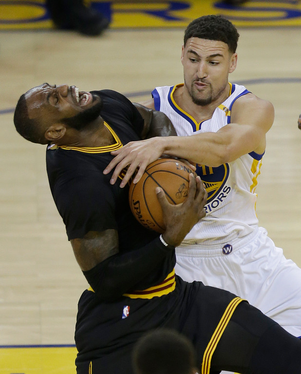 . Cleveland Cavaliers forward LeBron James, left, is fouled by Golden State Warriors guard Klay Thompson during the first half of Game 2 of basketball\'s NBA Finals in Oakland, Calif., Sunday, June 4, 2017. (AP Photo/Ben Margot)