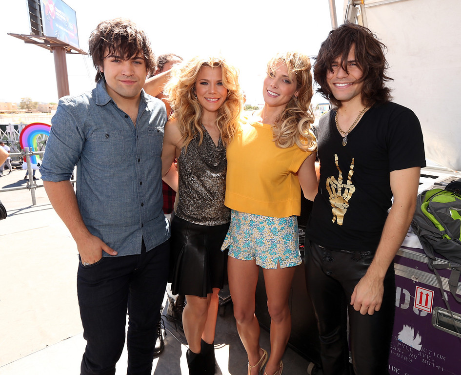 . (L-R) Musicians Neil Perry, Kimberly Perry, and Reid Perry of The Band Perry pose with actress Ashley Greene (2nd R) during the iHeart Radio Music Festival Village on September 21, 2013 in Las Vegas, Nevada.  (Photo by Christopher Polk/Getty Images for Clear Channel)