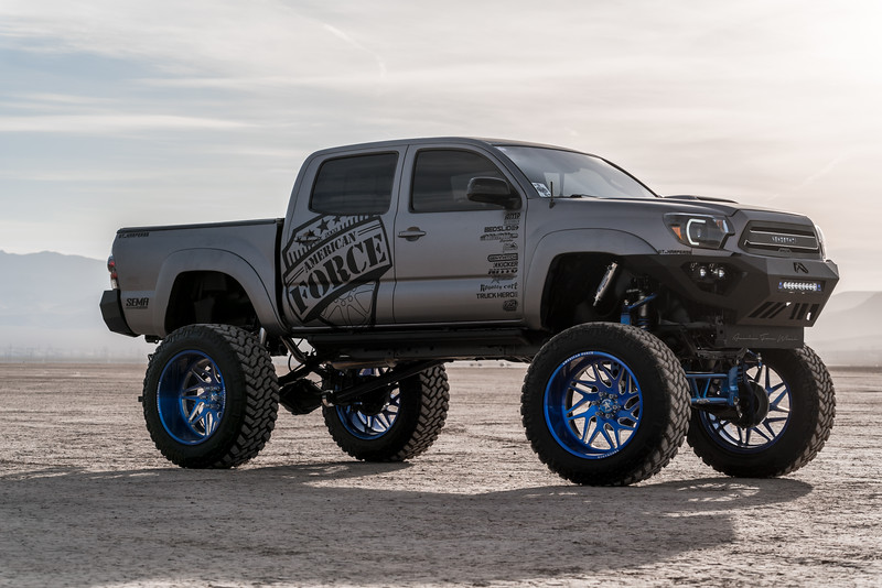 @T_harper96 @Vengeance_tacoma 2005-15 Toyota Tacoma featuring our New 2019 Concave 24x14 Lollipop Blue #GENESIS wrapped in 40x1550x24 @NittoTire-43.jpg