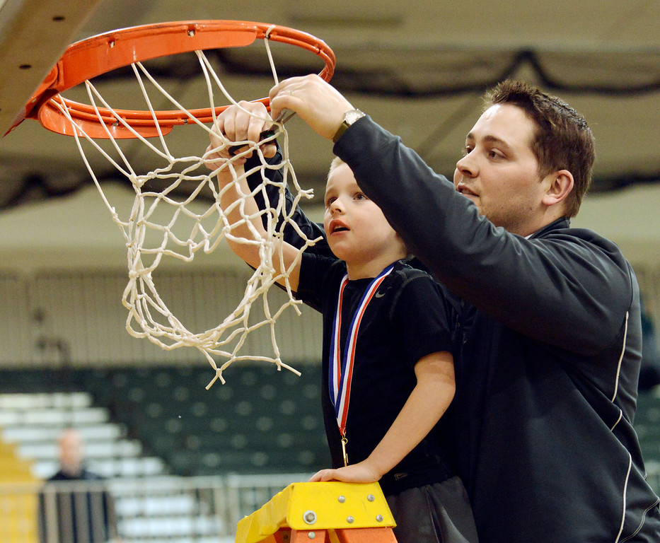 . Maribeth Joeright/MJoeright@News-Herald.com<p> Lake Catholic assistant coach Matt Moran and his son Brady cut the net after the team won the Divison II district chamionship, beating Chagrin Falls 68-59, March 8, 2014.