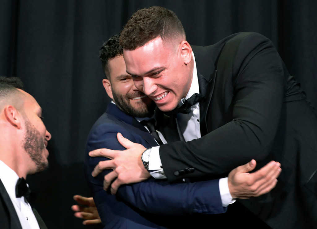 . Houston Astros Carlos Correa, left, watches as American League Rookie of the Year Aaron Judge, right, of the New York Yankees, embraces American League Most Valuable Player Jose Altuve, center, during a break in the New York Chapter of the Baseball Writers\' Association of America annual dinner in New York, Sunday, Jan. 28, 2018. (AP Photo/Kathy Willens)