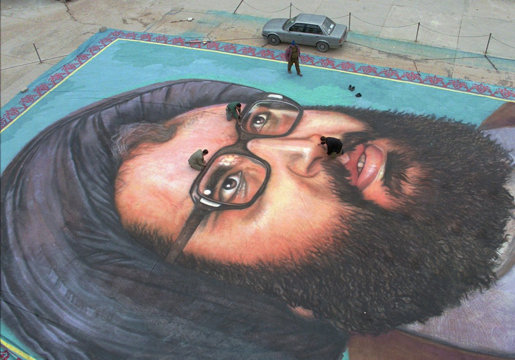 . Workers put the final touches on a large painting of Abbas Musawi, the former head of the Islamic fundamentalist group Hezbollah, in the southern Lebanese town of Nabatiyeh, Monday Jan. 19, 1998. The painting  will be on display in the southern port city of Tyre on Jan. 23 to mark Jerusalem Day. The portrait measures 131 feet high and 65 feet wide.  Musawi was killed in an Israeli helicopter gunship attack in southern Lebanon in 1992. (AP PHOTO/MOHAMED ZATARI)