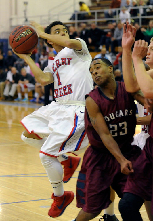 . GREENWOOD VILLAGE, CO. - FEBRUARY 13: Cherry Creek guard Caesar Jones gets fouled on the drive by Anthony Murray of Cherokee Trail in the first half Wednesday night at Cherry Creek High School. (Steve Nehf, The Denver Post)