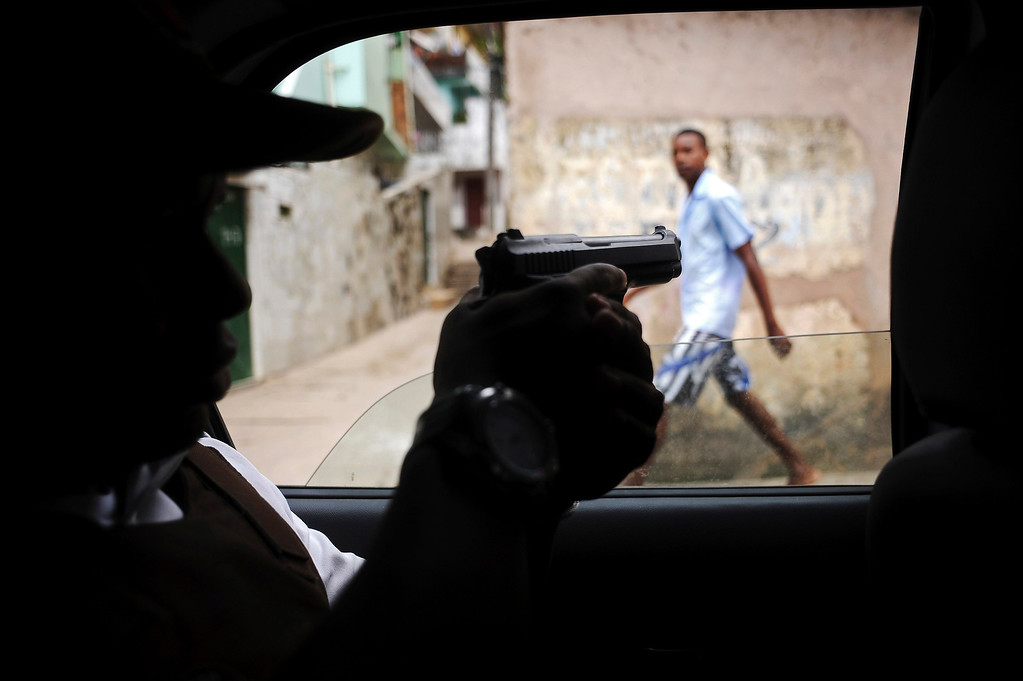 . Police patrol in the Nordeste de Amaralina slum complex in Salvador, Bahia State, March 28, 2013. One of Brazil\'s main tourist destinations and a 2014 World Cup host city, Salvador suffers from an unprecedented wave of violence with an increase of over 250% in the murder rate, according to the Brazilian Center for Latin American Studies (CEBELA). Picture taken March 28, 2013.  REUTERS/Lunae Parracho